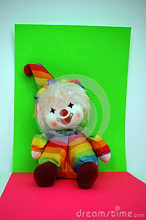 Rainbow Colored Clown Doll on Bright Background
