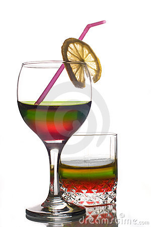 Rainbow colored drinks with straw and lemon