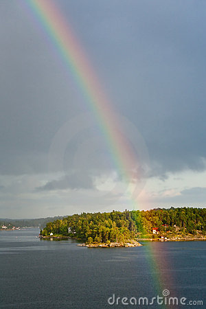 Free Rainbow In Rain During Sunshine In Sea Royalty Free Stock Images - 22102339