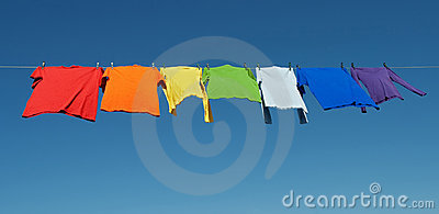 Rainbow laundry, bright shirts on a clothesline