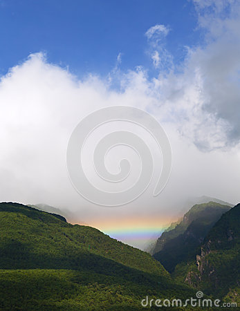 Rainbow in Mountain Valley
