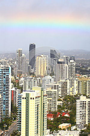 Rainbow over tower buildings aerial image Editorial Photo