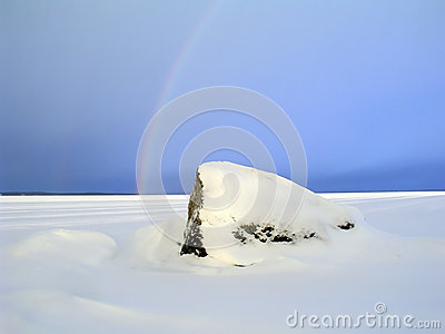 Rainbow over the frozen lake