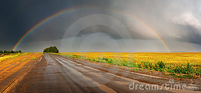 Rainbow over road