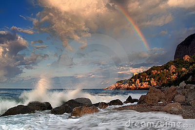 Rainbow over stormy sea