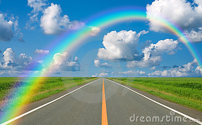 Rainbow over straight road