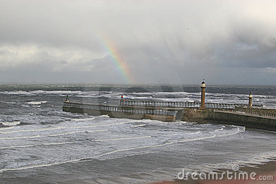 Rainbow over Whitby Harbour piers.
