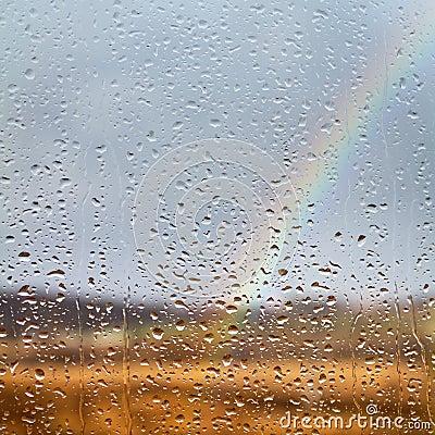 Rainbow through rained window