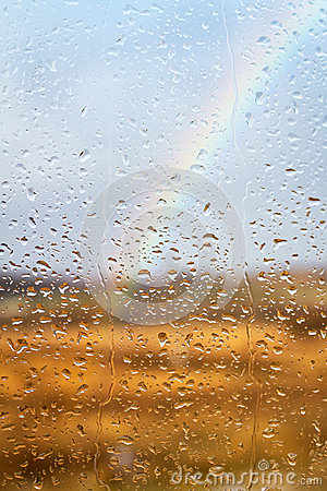 Rainbow through rained window background