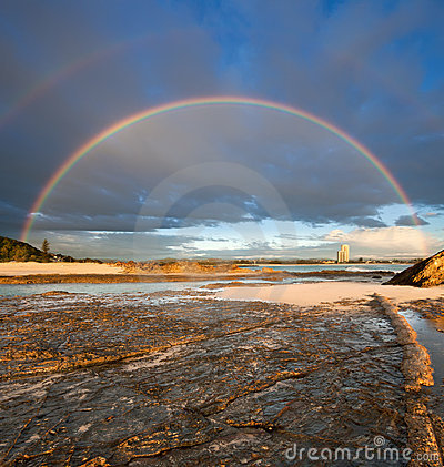 Rainbow with rock in foreground