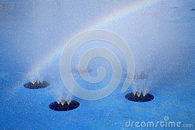 Rainbow and water fountain