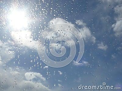 Raindrops and sunny sky