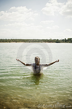 Raised arms in the water