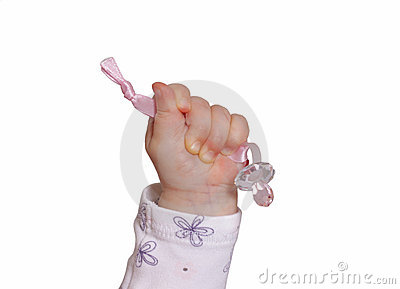 Raised baby hand with pacifier