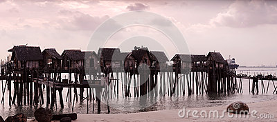 Raised shacks by the water