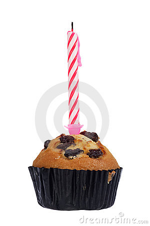 Raisin muffin with candle