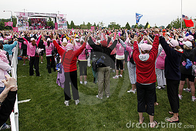 Raising hands at Avon Walk for Breast Cancer Editorial Stock Photo