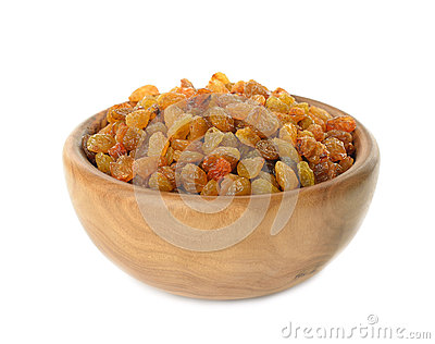 Raisins in a wooden bowl