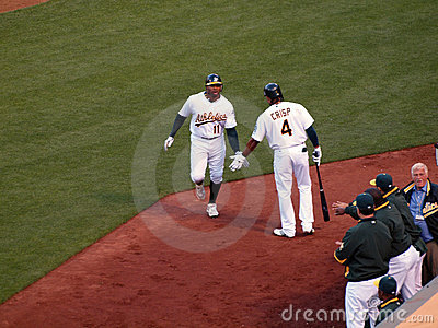 Raja Davis reaches to slap hands with Coco Crisp Editorial Stock Image