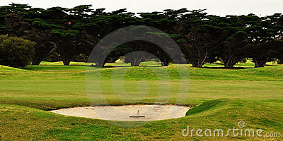 Rake in golf bunker