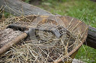 Rake on wheelbarrow