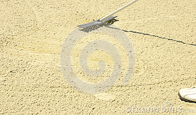 Raking the sand in the bunker