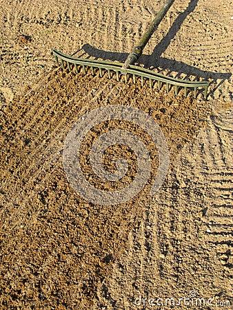 Free Raking Sand With A Golf Bunker Trap Rake. Stock Image - 7191311
