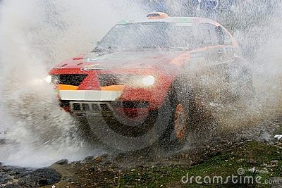 Rally car splashing water