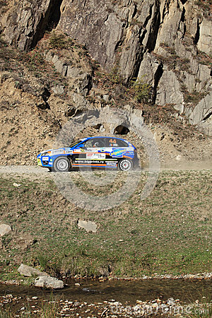 Rally racing taking place along a rivulet Editorial Stock Photo