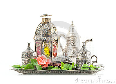 Ramadan kareem. Tea table setting withdates, mint leaves and ros Stock Photo