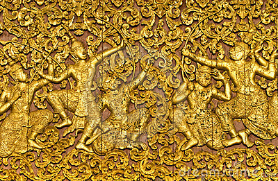 The ramayana epic carved on a wood door inside a t