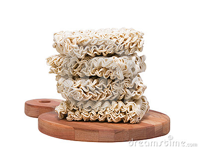 Ramen instant raw noodles on wooden plank front
