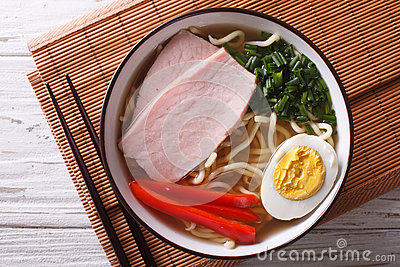 Ramen noodles in broth with pork in a bowl close up. Horizontal Stock Photo