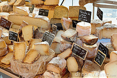 Random French cheese at market of Provence