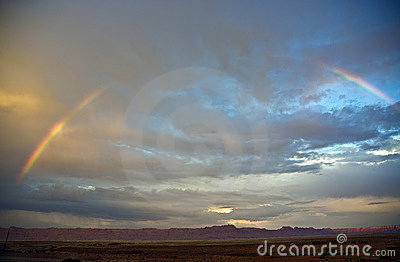 Range in spectacular sunset light with rainbow