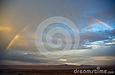 Range in spectacular sunset light with rainbow