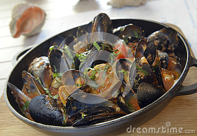 Rapana and mussels in tomato sauce