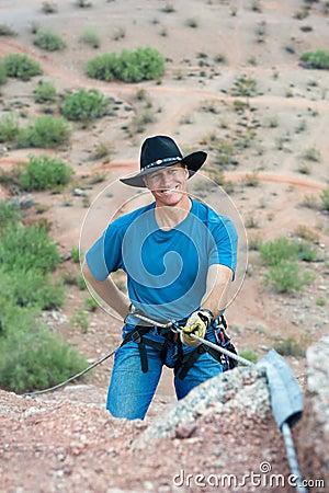 Rapelling rock climber