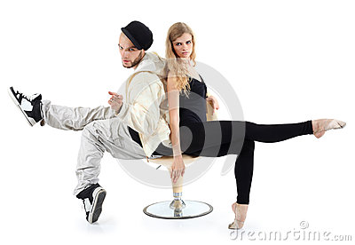 Rapper and ballerina sit on chair and look at camera