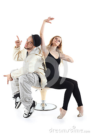Rapper and ballerina sit on chair and pose