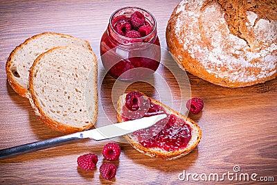 Rapsberry jam with slice of bread