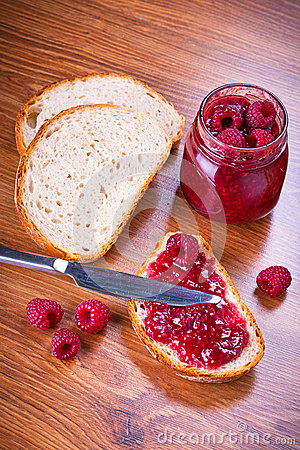 Rapsberry jam with slice of bread