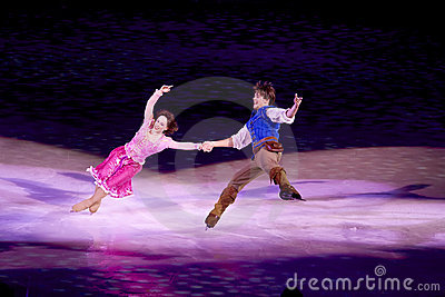 Rapunzel and Flynn dance during Disney on Ice Editorial Photo
