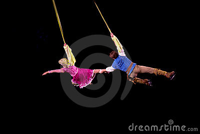 Rapunzel and Flynn fly in air during Disney on Ice Editorial Photo