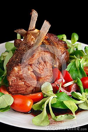 Rare fried rack of lamb isolated on black