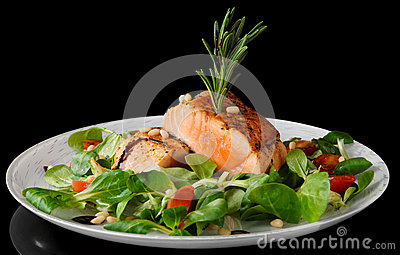 Rare fried salmon steaks  on black