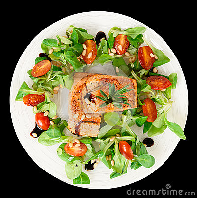 Rare fried salmon steaks isolated on black
