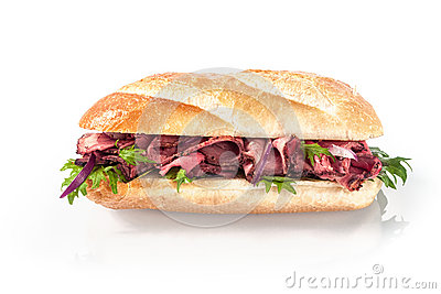 Rare roast beef and fresh rocket on a baguette