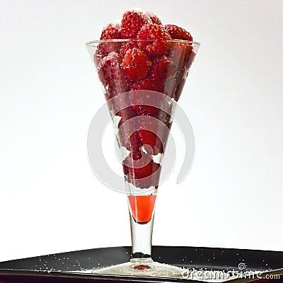 glass of raspberries