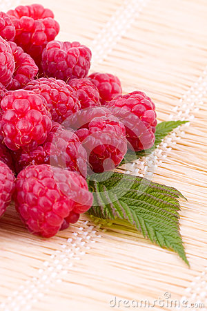 Raspberries on straw mat